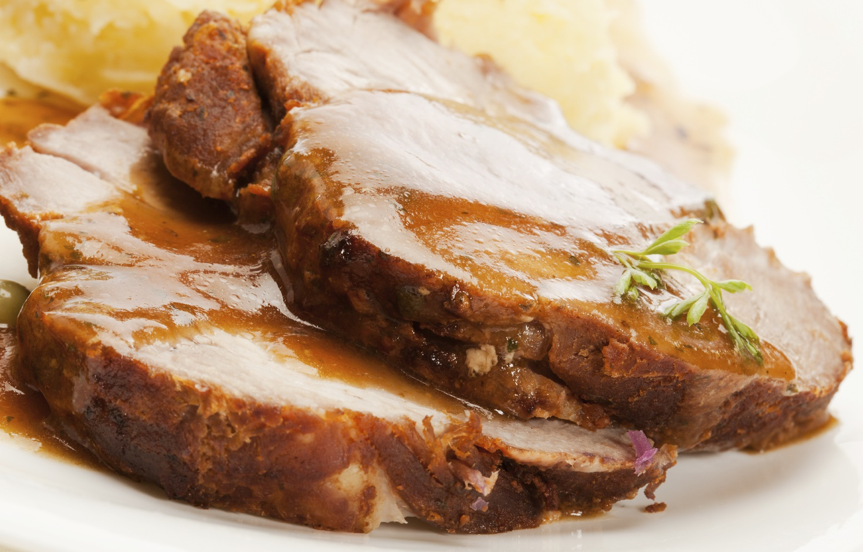Roast pork with sauce Spalla tal-majjal mixwija bil-basal tal-bużbież