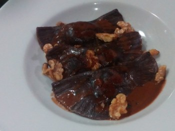Chocolate ravioli with a chocolate sauce and hazelnuts by Matthew Attard
