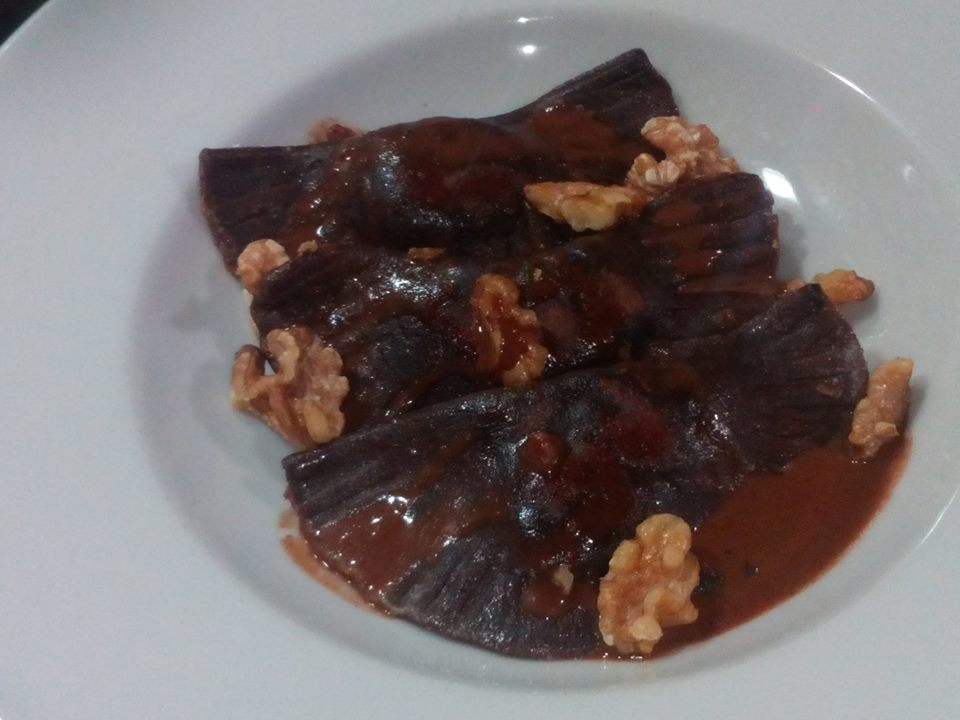 Chocolate ravioli with a chocolate sauce and hazelnuts by Matthew Attard