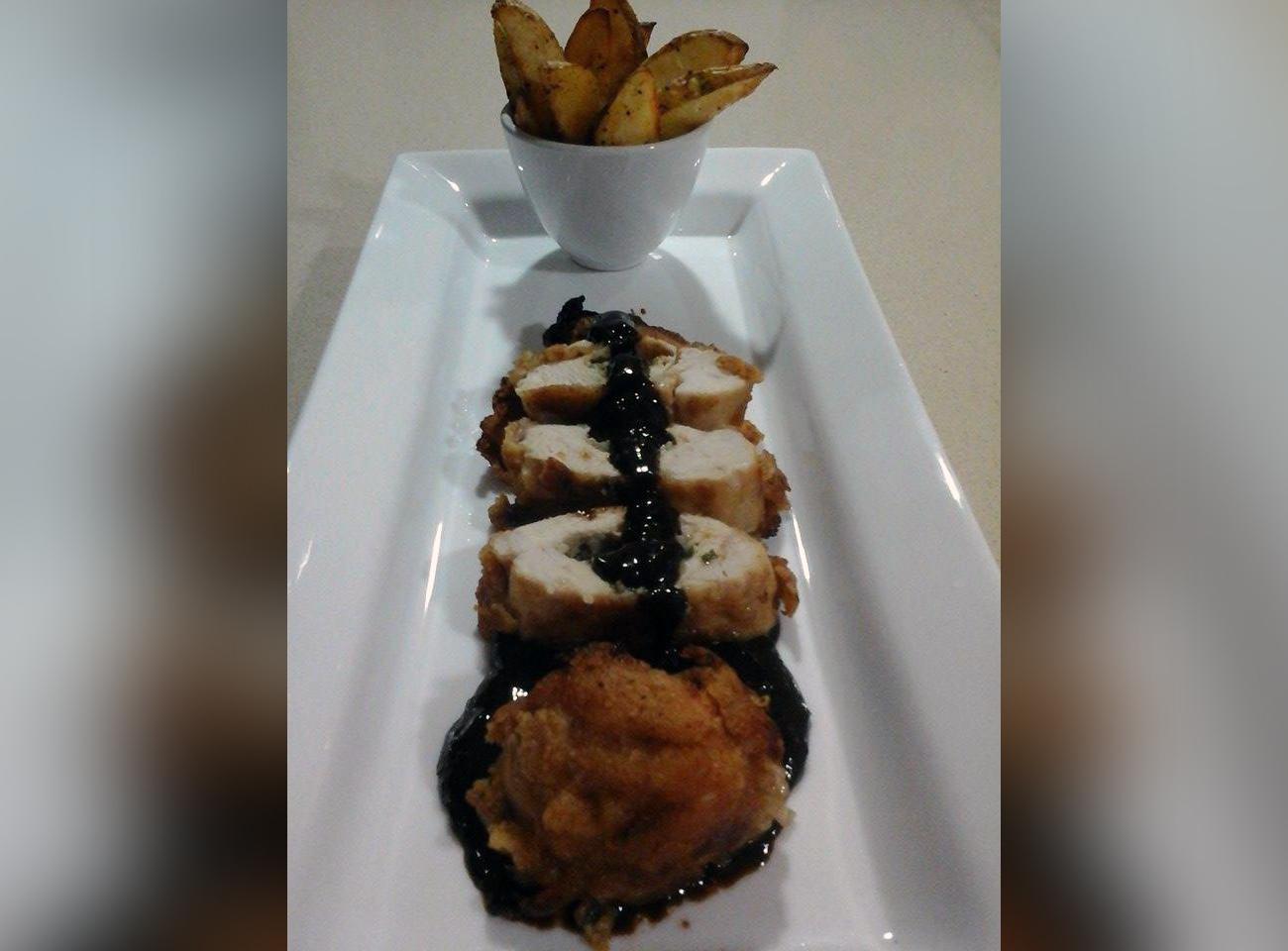 Walnut chicken kiev with chocolate bbq sauce served with potato wedges by Roberta Montfort
