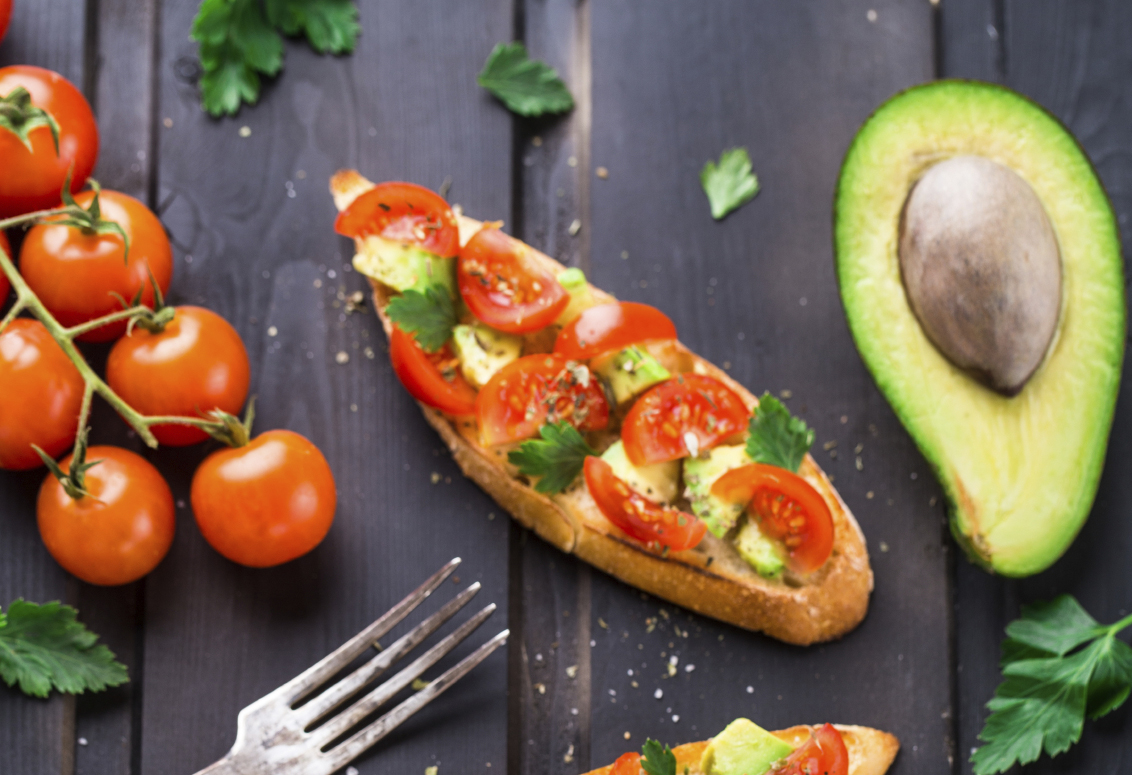 Bruschetta with tomato, avocado and herbs