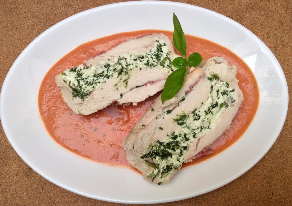 Stuffed chicken breast on fresh tomato sauce (Photo by Victoria Cassar)