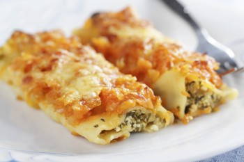 Cannelloni with ricotta cheese, tuna and spinach under tomato sauce